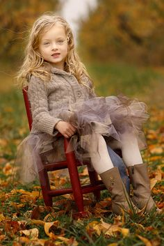 What a beautiful picture of this little girl - all the colors look so great for autumn! Love her skirt!