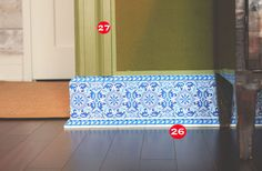 26. Baseboards in Moss's space are tromp l'oeil Delft tiles. 27. Velvet-covered walls are finished with a ribbon trim.