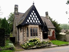 English gatehouse cottage... I love every detail from the chimneys to red ivy.