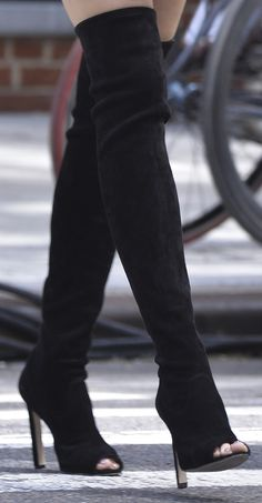 Sexy black thigh-high boots for Blake Lively's fourth look