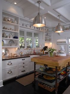Loving the old, the new, the industrial mix of this kitchen