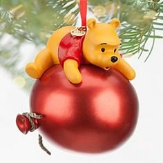 Disney Winnie the Pooh Sketchbook Ornament | Disney StoreWinnie the Pooh Sketchbook Ornament - Aboard his big red balloon, Pooh is just floating around - over the ground - waiting to wish you one ''hunny'' of a holiday season! This fun, fully-sculptured ornament is plussed by shimmering metallic paint.