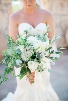 Photo credit: Heather Rowland Photography   Beautiful asymmetrical bouquet with white garden roses, silver dollars, scabiosas, roses, calycina, dahlias and a touch of queene anne's lace    Whim Florals   Camp Lucy