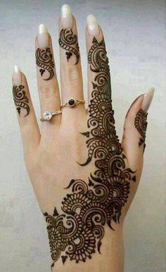 Beautiful Mehndi Designs...beautifully done mehndi design with a circular motif at the center. Love how the front and the back of the hand complement