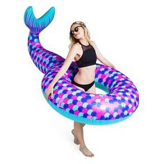 Mermaid pool float by Big Mouth Toys. When inflated, this float measures over 6 feet wide. Bright pink, blue, and purple colors. Float will hold up to 200 pounds. Made of vinyl.