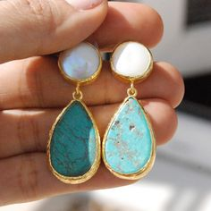 I prepared these earrings with pearls and drop cut turquoise stones. All my jewelry is hand crafted with pure and sterling silver. The gold color is done by coating silver with 18 karat gold. Each turquoise stone has its own texture and color which differ slightly from one another. Your pair