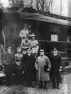 Painting of the signing of the Armistice with Germany November 11, 1919, inside a railway carriage. For the Allies (behind the table left to...