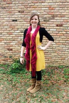 Yellow dress, plum color scarf, black shrug, black tights, moccasin boots, and two bracelets.