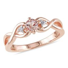 0.04 CT Diamond TW And 1/3 CT TGW Morganite Fashion Ring Pink Silver GH I2;I3 This 0.04 CT DTW and 1/3 CT TGW Morganite Ring crafted in Pink Silver comes in a stylish double infinity shape. The ring exudes an air of warmth and opulence, with the round diamond side stones (Color: GH, Clarity I2;I3) in 3 prong settings, enhancing the Morganite center. Amour is the outlet for one of the largest jewelry manufactures in North America.Founded in 1978, Amour retains facilities around the globe. A…