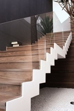 contemporary wooden staircase against a grey & white palette & glass