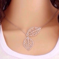 Leaf Necklace Pretty silver toned zinc alloy necklace. Chain is about 20 inches. Very light weight. New in package. Jewelry Necklaces