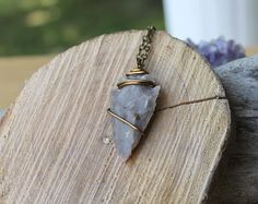 This beautiful stone arrowhead has been wire wrapped in bronze wire and measures around 2 long (including the bail - see photo #3). The stone arrowhead comes on a bronze chain - you get to pick the length of your bohemian jewelry! This is a genuine stone but the arrowhead is a reproduction! This was NOT found by us, it is a modern day carving. You will receive your arrowhead necklace in a lace gift bag, wrapped in tropical issue paper and ready for gift giving! Your bohemian jewelry should…