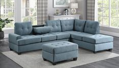 """Homelegance 9367BU*SC 2 pc Wildon home fossil blue textured fabric sectional sofa with reversible chaise drop down tray back. This set features a sofa with center drop down tray back, and reversible chaise lounge all with pocket coil seating. Sectional measures 112.5"""" x 81"""" x 33.5"""" D x 35.5"""" H. Some assembly required."""