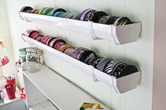 """Rain gutters are the perfect size for <a href=""""http://vintagechichome.blogspot.com/2011/09/ribbon-storage-solution-guttering.html"""" target=""""_blank"""">storing spools of ribbon</a>."""