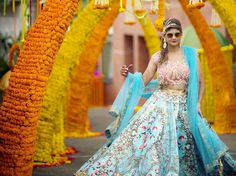 A Pink & Blue Lehenga with Floral Designs by Falguni & Shane Peacock for the mehendi ceremony of Real Bride Rachana Navale of WeddingSutra.