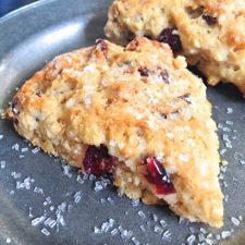 King Arthur Flour Christmas Scones recipe   kingarthurflour.com (as per their Whole Grain cookbook, I substituted cherries for the cranberries, almond slivers for the pecans and added 1/4 tsp. almond extract. Brushed tops with cream and sprinkled with turbinado sugar before baking. YUM!)