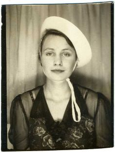 Photobooth: Young Woman Wearing A Hat, With A Look About Her