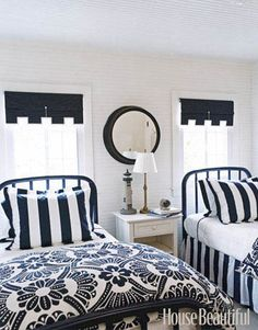 A Blue-and-White Guest Room  Designer Tom Stringer painted the headboards of these twin beds navy blue, then topped them with duvet covers from Anthropologie. Featured in the February 2008 issue.