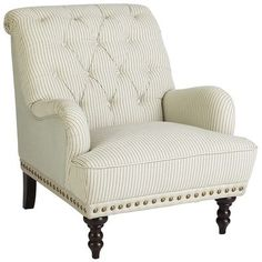 Pier 1 Imports - Chas Armchair - Seersucker: Not just for granddad's suits anymore. Overstuffed and tufted, this dandy armchair comes with vintage, handcrafted charm to spare—not to mention a rolled back and arms, ornamental nailhead trim, self-welting and turned hardwood legs. Blue-striped on the seat and arms, its back and seamed side panels are a soft, solid blue.