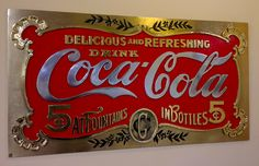 Reworked and re-adorned Coca-Cola sign at Baco Cuna 2 in Seville, Spain. Love it.