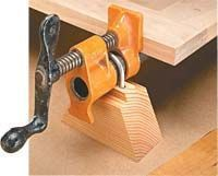 """Pipe Clamp Stand - woodworkingtips.com - from 2x4 cut 1 1/2"""" wide, rabbet down 3/8"""" on both sides of top for 1/2"""" wide each (leaves 1/2"""" sticking up). Attach to pipe clamp with 3/16"""" x 3"""" U-bolt and washers and nuts."""