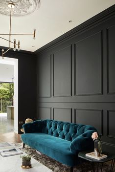 Sofa upholstered in teal velvet contrasts with dark grey painted wood panelling. Interior Photography of Wandsworth home, by London Architectural and Interiors photographer, Matt Clayton House Design, Room Design, Home, Living Room Decor, House Interior, Dark Interiors, Home Interior Design, Interior Design, Furniture Design