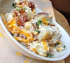 Loaded Baked Potato Salad.  Great twist on a picnic classic.  This recipe calls for light mayo/sour cream.