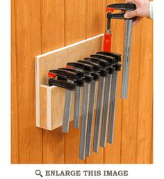 Woodworking Workshop Garage Easy-Store Clamp Rack Woodworking Plan from WOOD Magazine.Woodworking Workshop Garage Easy-Store Clamp Rack Woodworking Plan from WOOD Magazine Woodworking Workshop, Easy Woodworking Projects, Popular Woodworking, Woodworking Jigs, Woodworking Furniture, Diy Wood Projects, Woodworking Classes, Furniture Plans, Woodworking Articles