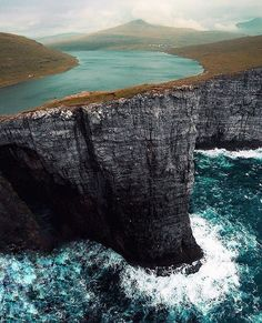 Via The Lake on a cliffs of ocean. Sørvágsvatn (or Leitisvatn) is the biggest lake of the Faroe Islands, situated on the island of Vágar. It covers an area of square km. Photo by Places To Travel, Places To See, Travel Destinations, Places Around The World, Around The Worlds, Wonderful Places, Beautiful Places, Beautiful Pictures, Destination Voyage