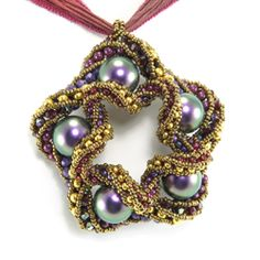 """Star Fragment Pendant by Cindy Holsclaw with spiraling """"Coiled CRAW"""" technique. Amazing"""