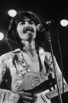 George Harrison performs on stage during his 'North American Tour'  in 1974.