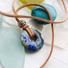 Handmade Lapis Lazuli Qi Pendant necklace, simple design, unique perfect gift, for any gender.  These Qi Beads are made from Canada, from a lapis lazuli Crystal Stone that is marbled, it has a denim quality in the colour.  The stone is 25 cm in width all round. It is presented beautifully in its own tissue lined gift box.
