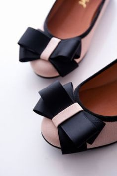 Pretty cute pink flats with black bow