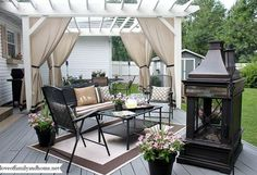 back deck makeover pergola reveal, decks, fireplaces mantels, outdoor furniture, outdoor living, painted furniture, A look at the space as a whole