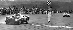 Palm Springs, November 1956. Era-famous start/finish flagger Al Torres jumps high as Carroll Shelby in the Edgar Ferrari 410S wins main ahead of Phil Hill's Ferrari Monza.