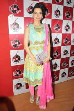 Kangana Ranaut in a Manish Arora suit while promoting her movie 'Queen'  For more images, click http://www.bigindianwedding.com/CollectionsAndTrends/Lehengas-Sarees/
