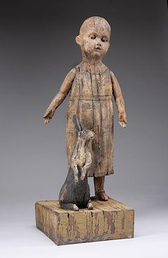 """Margaret Keelan - """"The Girl with the Rabbit"""", 2008  24"""" x 9"""" x 9"""" deep  Clay, stains"""