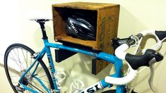 This is a fun repurpose of a wooden shelf to create a shelf and a bike rack.