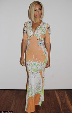 Fashion queen: The singer's floor length gown's combination of peach, lime and white looked stunning with her new hair
