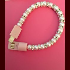 Bracelet charger for IPhone Never have a dead phone again it's super cute and always have a charge ! Great for school Jewelry Bracelets