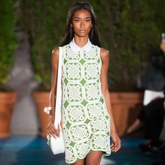 No one hosts a garden party quite like Tory Burch. For her Spring 2014 collection, which was inspired by the French Riviera in the 1960s, the designer invited us in to a botanical wonderland of greens and whites with hints of coral and the occasional