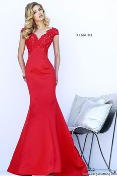 Sherri Hill 32029 Couture Gown, SHERRI HILL DRESSES, Prom dresses, Prom Dress, Evening wear. Flaunt the true you in Sherri Hill 32029. This elegant evening gown features V-neckline with open back tied with a bow. The fitted bodice is with V-back design is embellished with beads that will make you look dazzling. A full length trumpet skirt glides down the floor to give you a complete finish.