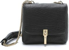 The perfect black mini cross body bag for night or day.