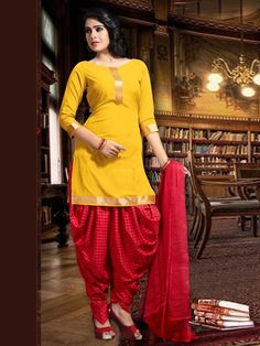 Aesthetic yellow color boat neck kameez planed on crepe fabric with golden lace hemline and placket part. Item Code: SLANA403 http://www.bharatplaza.com/new-arrivals/salwar-kameez.html