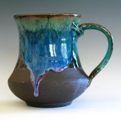 """4.5 tall, 3"""" opening, holds 18 oz    The dark clay used for this mug is fired to a deep, rich brown. Part of the exterior is left unglazed with light"""
