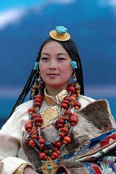 Tibet | Lady wearing the traditionally finery from Derge, at Litang Horse Festival 2007 | © BetterWorld2010. || For all of you interested in Tibetan (Kampa jewellery ) a visit to Shi Zi's boards is well worth it ( pinterest.com/... ) at the moment only about 150 pins but these have been split into the different ethnic regions within Tibet.