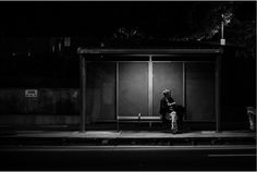 'Night Wait' by Los Angeles photographer Rinzi Ruiz highlights how something as routine and mundane as waiting for a bus at a bus stop during the night can be captured in a dramatic fashion. The woman is made the focal point through the bus shelter light above her. despite it being at night it is a strong street image in my opinion