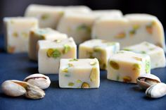 Bailey's Irish Cream and Pistachio Fudge  makes one 9x9 square pan  adapted from Eat Good 4 Life    36 ounces white chocolate chips  1 14-ounce can sweetened condensed milk  6 tablespoons Bailey's Irish Cream  1/3 cup pistachios, blanched and chopped (more is okay)