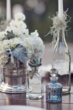 blue and silver table decor     greenweddingshoes.com   For similar stock for your South African wedding and more inspiration: www.facebook.com/labolaweddings