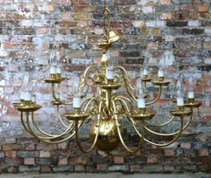 Large brass two-tier Flemish baroque style chandelier
